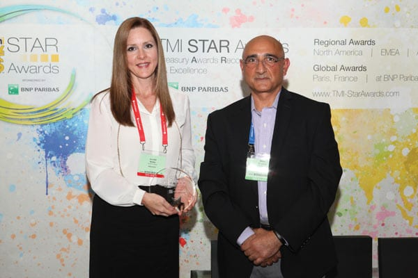 Jennifer collecting the TMI Star Award with Walid Shuman
